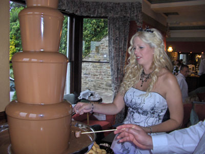 Vicky looking very beautiful enjoying the chocolate fountain.