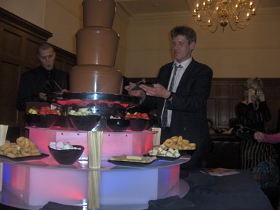Two good looking chaps enjoying a couple of dips in the chocolate fountain.